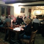 Pub Quiz - teams working on answers